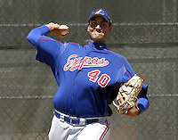 April 1, 2004:  Pitcher Chris Young of the Montreal Expos (Washington Nationals) organization during Spring Training at Osceola County Stadium in Kissimmee, FL.  Photo copyright Mike Janes/Four Seam Images