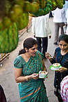 MUMBAI, INDIA - SEPTEMBER 27, 2010: A customer enjoys some exotic friut and curd from the Haji Ali Juice Centre at the mainland entrance to the tomb of Haji Ali, a Muslim famous shrine set off the coast of Mahalakshmi in Mumbai.The Taj Mahal Palace and Tower Hotel in Mumbai has re-opened after the terror attacks of 2008 destroyed much of the heritage wing. The wing has been renovated and the hotel is once again the shining jewel of Mumbai. pic Graham Crouch