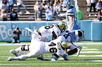 CHAPEL HILL, NC - NOVEMBER 14: D.J. Taylor #46 and Trey Rucker #18 of Wake Forest combine to tackle Michael Carter #8 of North Carolina during a game between Wake Forest and North Carolina at Kenan Memorial Stadium on November 14, 2020 in Chapel Hill, North Carolina.