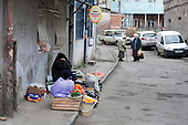 An elderly woman sells fruit and vegetables in the street in Old Tbilisi, Georgia.
