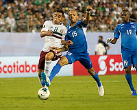 CHARLOTTE, NC - JUNE 23: Audrick Linord #15 defends against Carlos Rodriguez #8 during a game between Mexico and Martinique at Bank of America Stadium on June 23, 2019 in Charlotte, North Carolina.