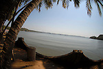 View looking up the Mandovi River from near Coco Beach in Goa in India.