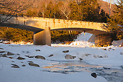 Road Bridge during the in winter months. This bridge crosses the East Branch of the Pemigewasset River in Lincoln, New Hampshire USA along Kancamagus Scenic Byway (Route 112).