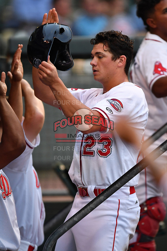 Third baseman Bobby Dalbec (23) of Greenville Drive is congratulated after scoring a run in a game against the Asheville Tourists on Wednesday, May 3, 2017, at Fluor Field at the West End in Greenville, South Carolina. Greenville won, 8-0. (Tom Priddy/Four Seam Images)