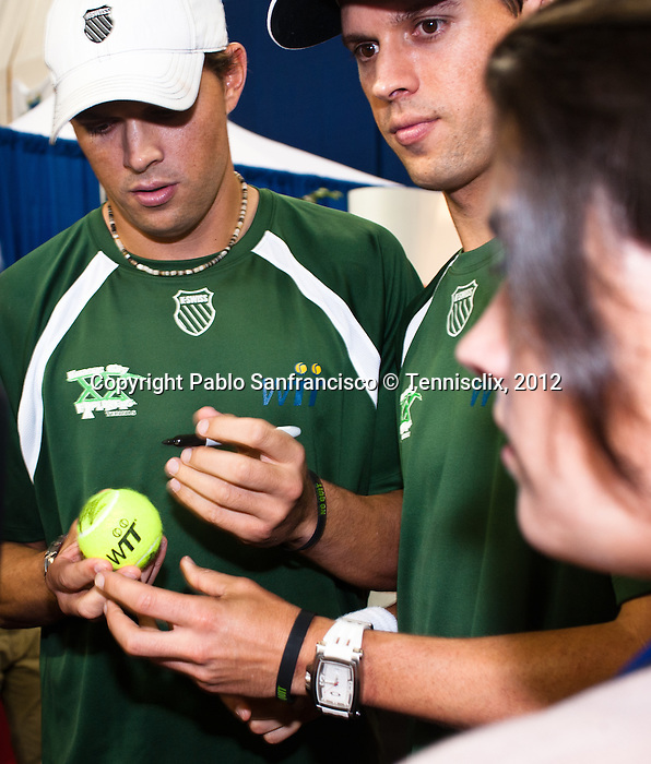 Bob and Mike Bryan sign autographs prior to their Freedoms vs. Explorers WTT match in Villanova, PA on July 16, 2012