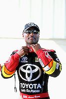 Sep 29, 2013; Madison, IL, USA; NHRA top fuel dragster driver Antron Brown during the Midwest Nationals at Gateway Motorsports Park. Mandatory Credit: Mark J. Rebilas-