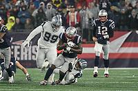 FOXBOROUGH, MA - NOVEMBER 24: New England Patriots Runningback Sony Michel #26 tackled by Dallas Cowboys Cornerback Byron Jones #31 after a short run during a game between Dallas Cowboys and New England Patriots at Gillettes on November 24, 2019 in Foxborough, Massachusetts.
