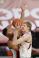 Arkansas forward Connor Vanover (23) shoots as Georgia Toumani Camara (10) blocks, Saturday, January 9, 2021 during the first half of a basketball game at Bud Walton Arena in Fayetteville. Check out nwaonline.com/210110Daily/ for today's photo gallery. <br /> (NWA Democrat-Gazette/Charlie Kaijo)