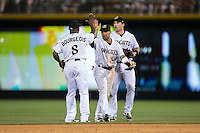 (L-R) Jason Bourgeois (8), Leury Garcia (24), and Vinny Rottino (4) celebrate their win over the Indianapolis Indians at BB&T BallPark on June 17, 2016 in Charlotte, North Carolina.  The Knights defeated the Indians 4-0.  (Brian Westerholt/Four Seam Images)