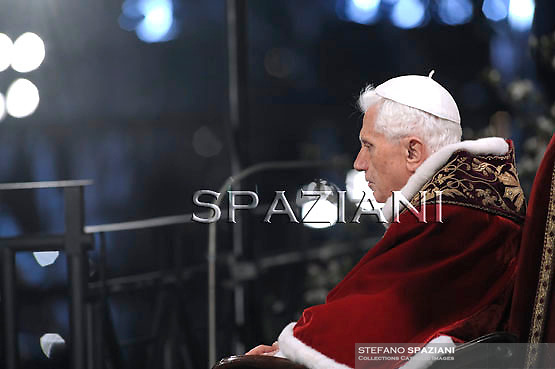 Pope Benedict XVI holds the wooden cross during the Via Crucis (Way of the Cross) torchlight procession on Good Friday in front of the Colosseum in Rome, Friday, April 22, 2011.The evening Via Crucis procession at the ancient Colosseum amphitheater is a Rome tradition that draws a large crowd of faithful, including many of the pilgrims who flock to the Italian capital for Holy Week ceremonies before Easter SundayVia Crucis;
