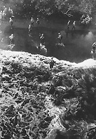 Marines hit three feet of rough water as they leave their LST to take the beach at Cape Gloucester, New Britain.  December 26, 1943.  Sgt. Robert M. Howard.  (Marine Corps)<br /> NARA FILE #:  127-N-68998<br /> WAR & CONFLICT BOOK #:  1169
