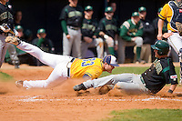 Alex Grubb #33 of the North Carolina A&T Aggies makes a diving tag on Kevin Gillespie #9 of the Charlotte 49ers as he tries to score on a wild pitch at War Memorial Stadium March 23, 2010, in Greensboro, North Carolina.  Photo by Brian Westerholt / Four Seam Images