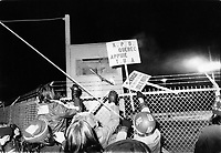 Undated file photo from the 1970's - United Aircraft employes set signs on fire and throw them over the company fence,<br />  during the strike that lasted from January 9, 1974 to May 20, 1975.<br /> <br /> It was one of the most violent conflict labour conflict of Quebec