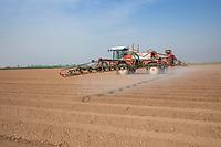 Applying residual herbicide to potato ridges - Lincolnshire, April