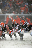 December 16th, 2007:  Cleveland Browns quarterback Derek Anderson (3) calls the signals as offensive lineman Eric Steinbach (65) and Derrick Dockery (66) get ready at Cleveland Browns Stadium in Cleveland, Ohio.  The Browns shutout the Bills 8-0.  Photo copyright Mike Janes Photography 2007.