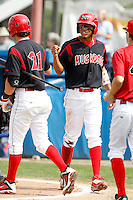 Batavia Muckdogs outfielder Reggie Williams #3 is congratulated by Garrett Wittels #21 after scoring on a squeeze play during a game against the Auburn Doubledays at Dwyer Stadium on September 4, 2011 in Batavia, New York.  Batavia defeated Auburn 4-2.  (Mike Janes/Four Seam Images)