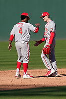 Freshman pitcher Jason Savacool (45) of the Maryland Terrapins, making his collegiate debut, pitched a complete-game 3-2 win against the Michigan State Spartans on Sunday, March 7, 2021, at Fluor Field at the West End in Greenville, South Carolina. Here he slaps hands with first baseman Maxwell Costes (4) after the final out. (Tom Priddy/Four Seam Images)(Tom Priddy/Four Seam Images)