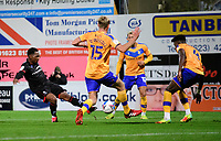 Lincoln City's Tayo Edun has a shot at goal under pressure from Mansfield Town's Aaron O'Driscoll, left, and Mansfield Town's Rollin Menayese<br /> <br /> Photographer Andrew Vaughan/CameraSport<br /> <br /> EFL Trophy Northern Section Group E - Mansfield Town v Lincoln City - Tuesday 6th October 2020 - Field Mill - Mansfield  <br />  <br /> World Copyright © 2020 CameraSport. All rights reserved. 43 Linden Ave. Countesthorpe. Leicester. England. LE8 5PG - Tel: +44 (0) 116 277 4147 - admin@camerasport.com - www.camerasport.com