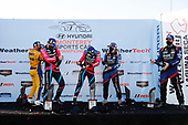 #86 Meyer Shank Racing w/Curb-Agajanian Acura NSX GT3, GTD: Mario Farnbacher, Matt McMurry, #57 Heinricher Racing w/MSR Curb-Agajanian Acura NSX GT3, GTD: Alvaro Parente, Misha Goikhberg, podium, #96 Turner Motorsport BMW M6 GT3, GTD: Robby Foley III, Bill Auberlen, champagne