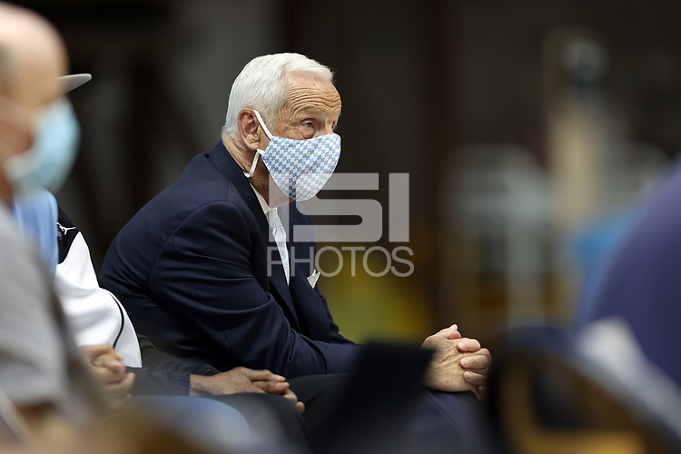 CHAPEL HILL, NC - APRIL 6: Newly retired UNC head coach Roy Williams watches during the Hubert Davis (not pictured) introductory press conference at Dean E. Smith Center on April 6, 2021 in Chapel Hill, North Carolina.