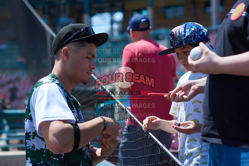 Lake Elsinore Storm outfielder Tirso Ornelas (23) signs an autograph before a California League game against the Inland Empire 66ers on April 14, 2019 at The Diamond in Lake Elsinore, California. Lake Elsinore defeated Inland Empire 5-3. (Zachary Lucy/Four Seam Images)
