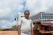 Pará State, Brazil. Vitoria do Xingu. Lorry driver Reinaldo.