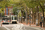 Trimet MAX lightrail train and bus at the Portland Transit Mall in Portland, OR.