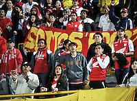 BOGOTA - COLOMBIA -26 -03-2014: Hinchas de Independiente Santa Fe, animan a su equipo durante partido aplazado entre Independiente Santa Fe y Envigado Chico FC por la fecha 10 de la Liga Postobon I-2014, jugado en el estadio Nemesio Camacho El Campin de la ciudad de Bogota.  / Fans of Independiente Santa Fe cher for their team during a posponed match between Independiente Santa Fe and Envigado FC for the 10th date of the Liga Postobon I -2014 at the Nemesio Camacho El Campin Stadium in Bogota city, Photo: VizzorImage  / Luis Ramirez / Staff.