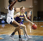 SIOUX FALLS, SD - MARCH 7: Jada Mickens #32 of the UMKC Kangaroos defends as Danni Nichols #4 of the Western Illinois Leathernecks drives to the basket during the Summit League Basketball Tournament at the Sanford Pentagon in Sioux Falls, SD. (Photo by Richard Carlson/Inertia)