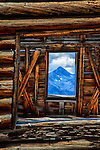 Colorado mountain peak as seen through the window of an abandoned building in a ghost town