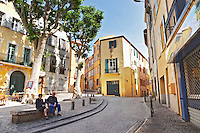 Street in the old town. An old couple. Perpignan, Roussillon, France.