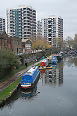 Houseboats on the Regent's Canal in Hoxton, London.  There is high demand for temporary and residential moorings as a shortage of affordable housing has seen a sharp increase in numbers of those seeking to live on the canal.