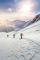 Group of skiers led by a mountain guide on the approach to Col de la Terrasse (2640m).<br />