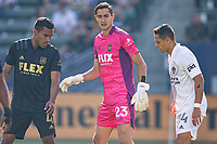CARSON, CA - MAY 8: Eddie Segura #4 and Pablo Sisniega #23 of LAFC post up near Javier Hernandez #14 of the Los Angeles Galaxy during a game between Los Angeles FC and Los Angeles Galaxy at Dignity Health Sports Park on May 8, 2021 in Carson, California.