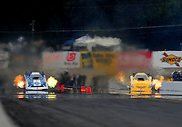 Oct. 1, 2011; Mohnton, PA, USA: NHRA funny car driver Tim Wilkerson (left) races alongside Jeff Arend during qualifying for the Auto Plus Nationals at Maple Grove Raceway. Mandatory Credit: Mark J. Rebilas-
