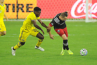 WASHINGTON, DC - OCTOBER 28: Russell Canouse #4 of D.C. United battles for the ball with  Fatai Alashe #26 of Columbus Crew SC during a game between Columbus Crew and D.C. United at Audi Field on October 28, 2020 in Washington, DC.