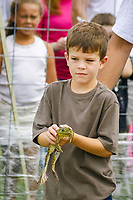 children and frog, Annual Valley City Frog Jumping Contest, Valley City, Ohio, USA