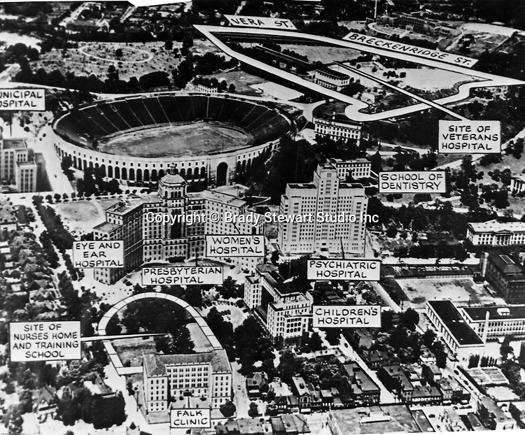 """Pittsburgh PA:  Aerial View of Pitt Stadium, Presbyterian and Children Hospitals with artwork call outs of future development projects. Brady Stewart Studio was responsible for the aerial photography and Ingram Boyd and Pratt were responsible for creating the """"artist's rendering"""" of the area with existing and new projects on the Pitt campus. Ingham, Boyd, and Pratt were one of the premier architects in Pittsburgh and did a lot of work for universities, hospitals, and local school districts in the Pittsburgh area. The successor firm is IKM, Inc."""