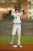Chase Griffin (23) of the Georgia Southern Eagles gives the deer antlers sign to his teammates after hitting a double against the UNCG Spartans at UNCG Baseball Stadium on March 29, 2013 in Greensboro, North Carolina.  The Spartans defeated the Eagles 5-4.  (Brian Westerholt/Four Seam Images)