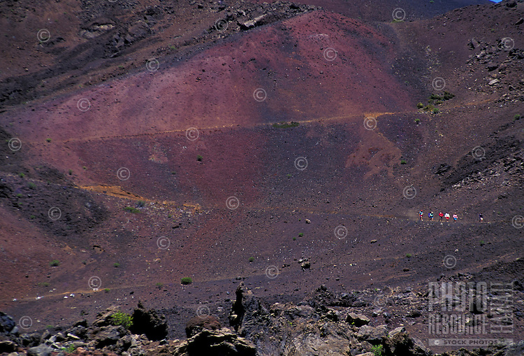 Hikers on sliding sands trail, also know as Keoneheehee, Haleakala Crater. Island of Maui.