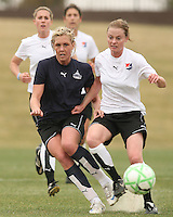 Allie Long (blue) of the Washington Freedom is beaten to the ball by Jen Buczkowski  of Sky Blue F.C. during a WPS pre season match at Maryland Soccerplex, in Boyd's, Maryland on March 14 2009. Sky Blue won the match 1-0
