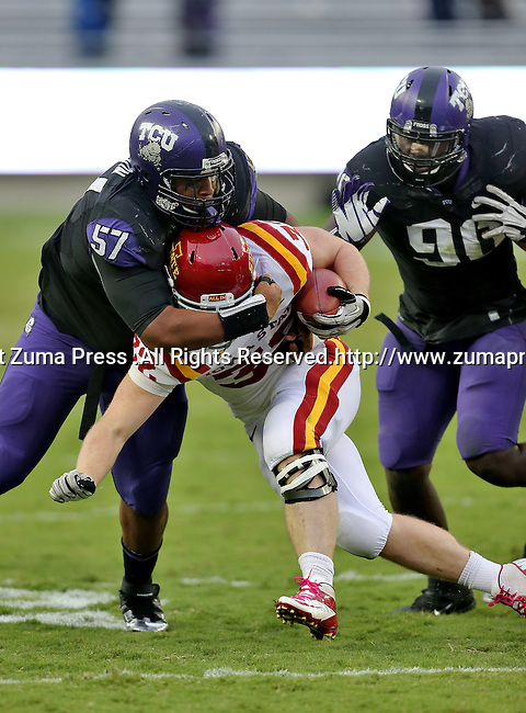 Iowa State Cyclones running back Jeff Woody (32) and TCU Horned Frogs defensive tackle Davion Pierson (57) in action during the game between the Iowa State Cyclones and the TCU Horned Frogs  at the Amon G. Carter Stadium in Fort Worth, Texas. Iowa State defeats TCU 37 to 23....
