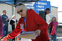 Experimental Aircraft Association volunteer Meg Hurt matches pilots and young people about to go for a flight at an EAA Young Eagles Rally at Lampson Field (102), Lakeport, California