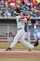 Chattanooga Lookouts second baseman Levi Michael (9) swings at a pitch during a game against the Tennessee Smokies on April 25, 2015 in Kodak, Tennessee. The Smokies defeated the Lookouts 16-10. (Tony Farlow/Four Seam Images)