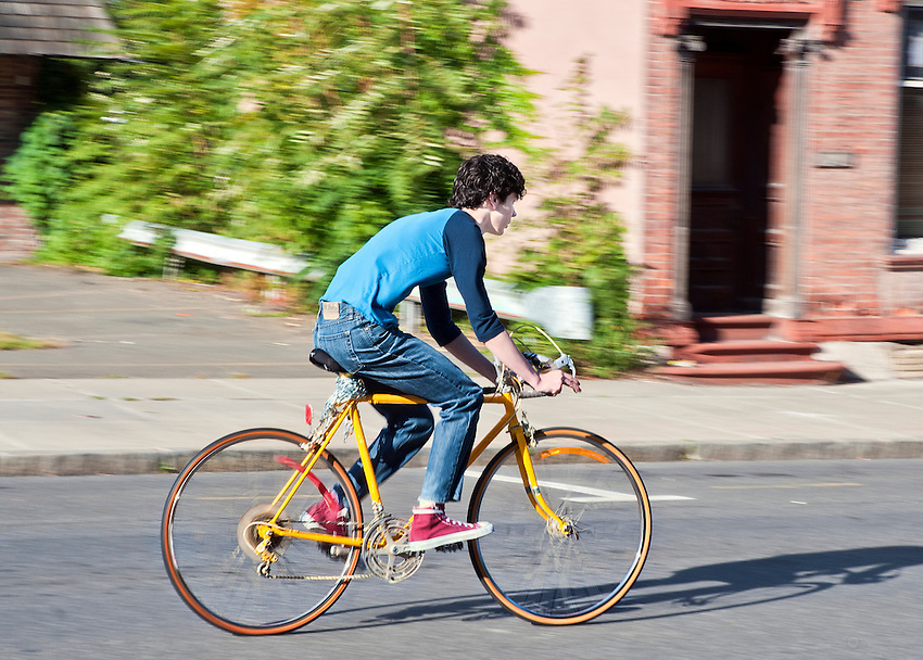 Ian riding the bicycle on Warren Street.