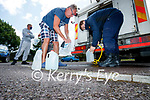 Danny Flynn filling up water from a tanker at Saint Brendan's church, Tralee on Wednesday.