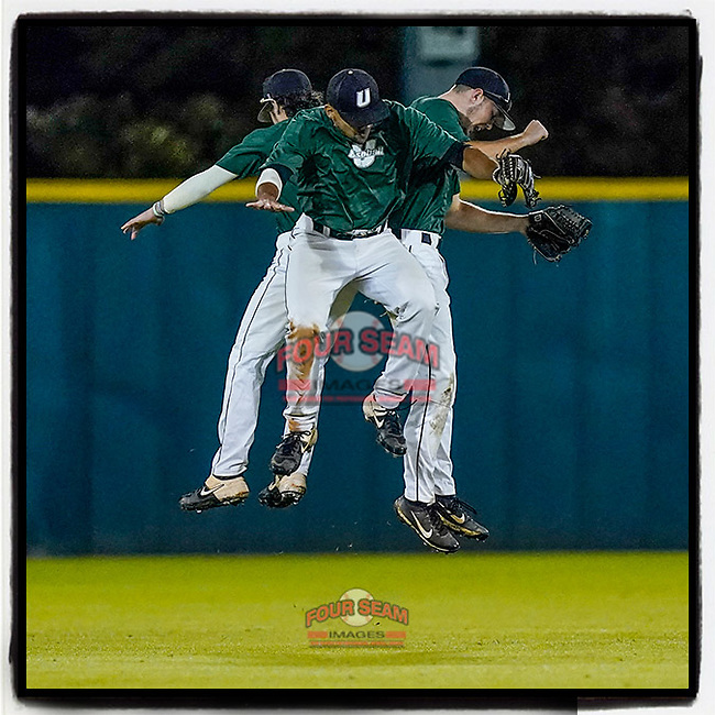 Outfielders from the University of South Carolina Spartans Green team jump and bump to celebtrate an 8-0 win in the Green and Black Fall World Series Game 4 on Wednesday, November 4, 2020, at Cleveland S. Harley Park in Spartanburg, South Carolina. (Tom Priddy/Four Seam Images)