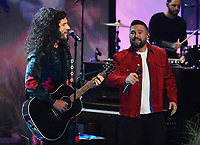 """HOLLYWOOD, CA - MAY 27: Shay Mooney and Dan Smyers of Dan + Shay performs on the 2021 """"iHeartRadio Music Awards"""" airing live from The Dolby Theatre in Los Angeles, Thursday, May 27 (8:00-10:00 PM ET live / PT tape-delayed) on FOX.  (Photo by Frank Micelotta/FOX/PictureGroup)"""