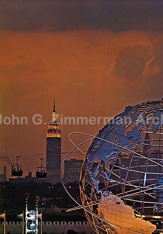 View of the 1964 World's Fair in New York at sunset with the Unisphere and the Empire State Building. Taken from atop the Fair's Better Living Pavillion. Photo by John G. Zimmerman.