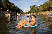 Barton Springs Pool is a man-made recreational swimming pool located on the grounds of Zilker Park in Austin, Texas. The pool exists in the channel of Barton Creek and is filled by water from Main Barton Spring, the fourth largest spring in Texas.